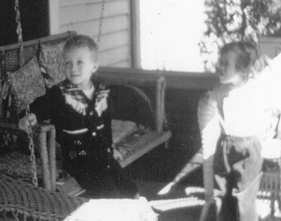 I did get a little huffy sometimes. With my brother Curt on my grandparents' front porch.