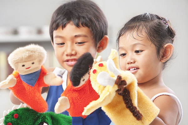 Children playing with puppets
