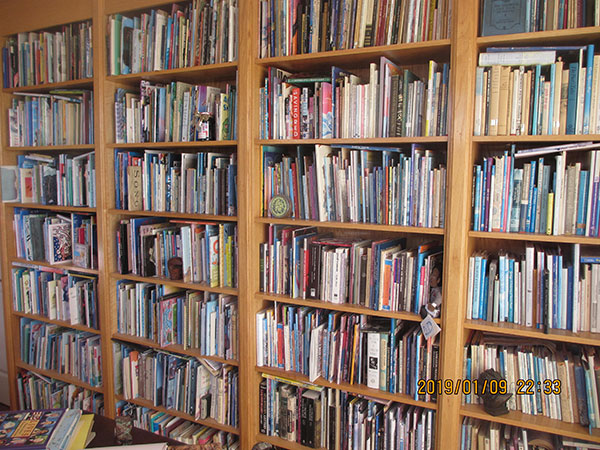 Some of the bookshelves in Lee Bennett Hopkins' office