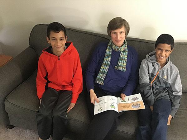 Adam, Anita, and Caleb reading Scaredy Squirrel
