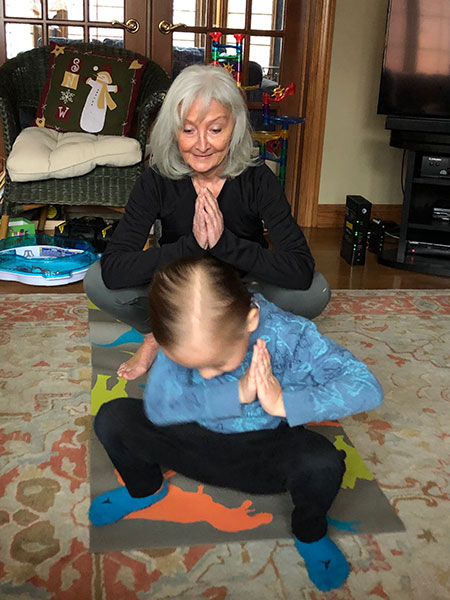 Ann and Teddy practice yoga