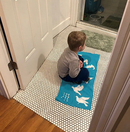boy sitting on peace blanket