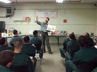 McDougall reading to inmates