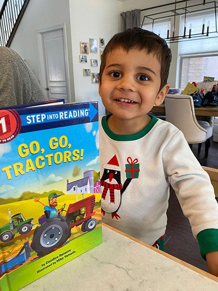 Nikhil reading Go, Go Tractors!