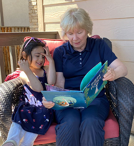 Priya and Grandma reading Birds of a Feather
