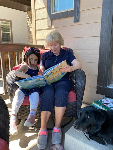 Priya and Grandma reading Rare and Blue
